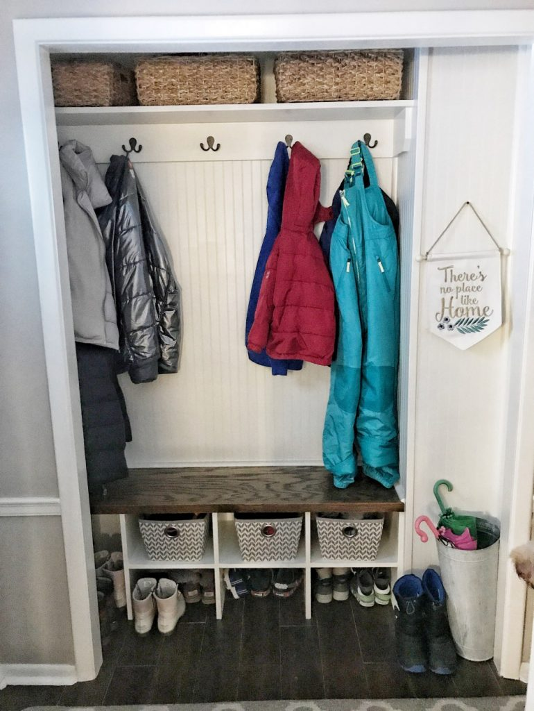 A mudroom using a closet space